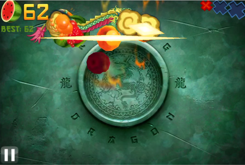 Screenshot of a horizontal swipe slicing several fruit in half in Fruit Ninja